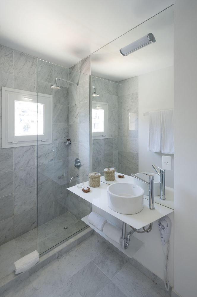 bathroom property sink bathtub plumbing fixture home toilet flooring tiled