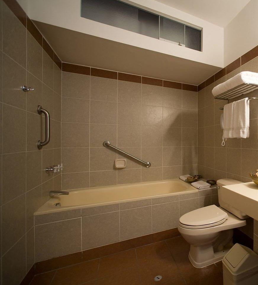 bathroom property toilet house sink home plumbing fixture flooring tile bathtub tiled