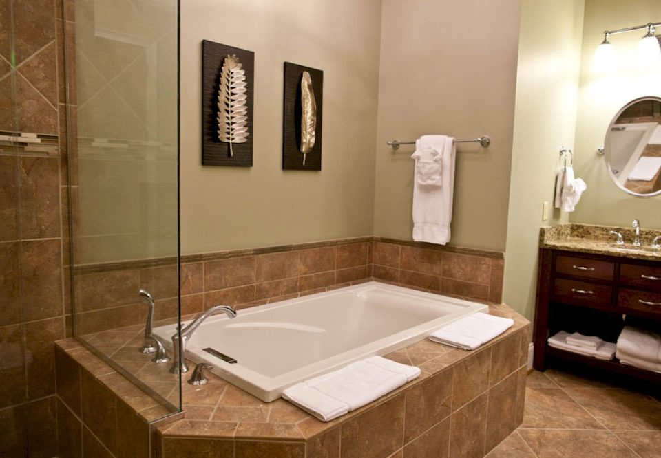 bathroom sink property mirror toilet plumbing fixture home vessel flooring bathtub tan