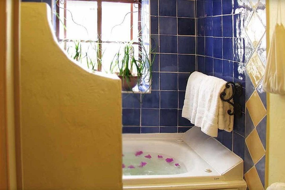 bathroom property house home plumbing fixture flooring bathtub tiled