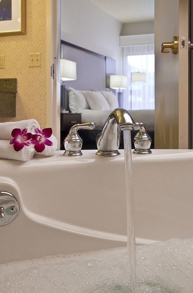 bathroom mirror sink property flooring bathtub home plumbing fixture toilet