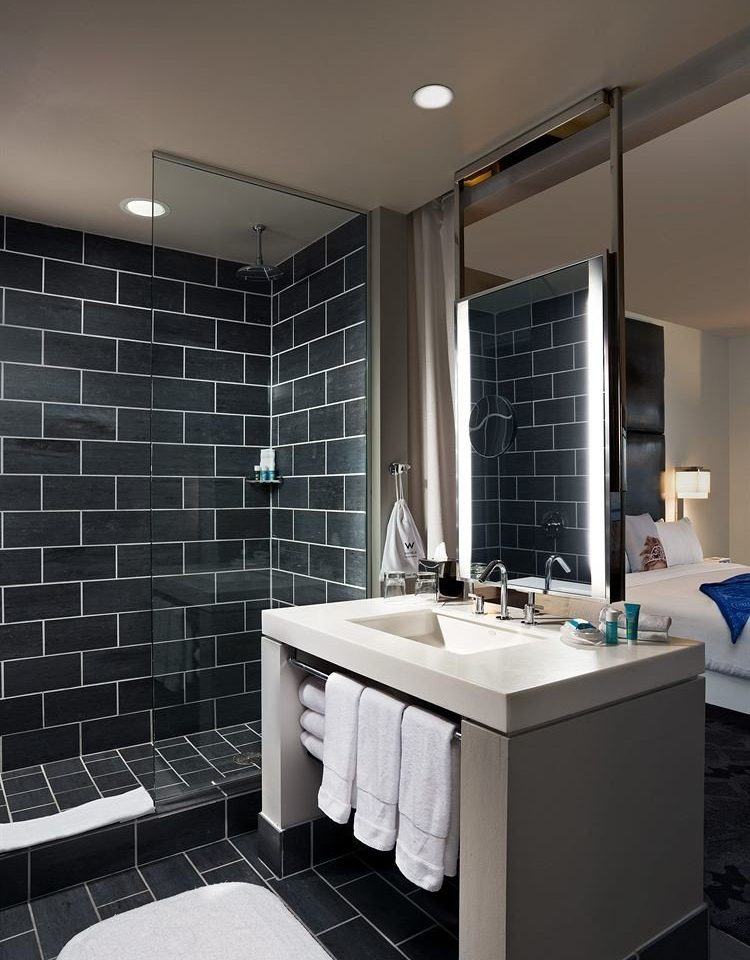 bathroom sink lighting white plumbing fixture tile flooring bathtub tiled