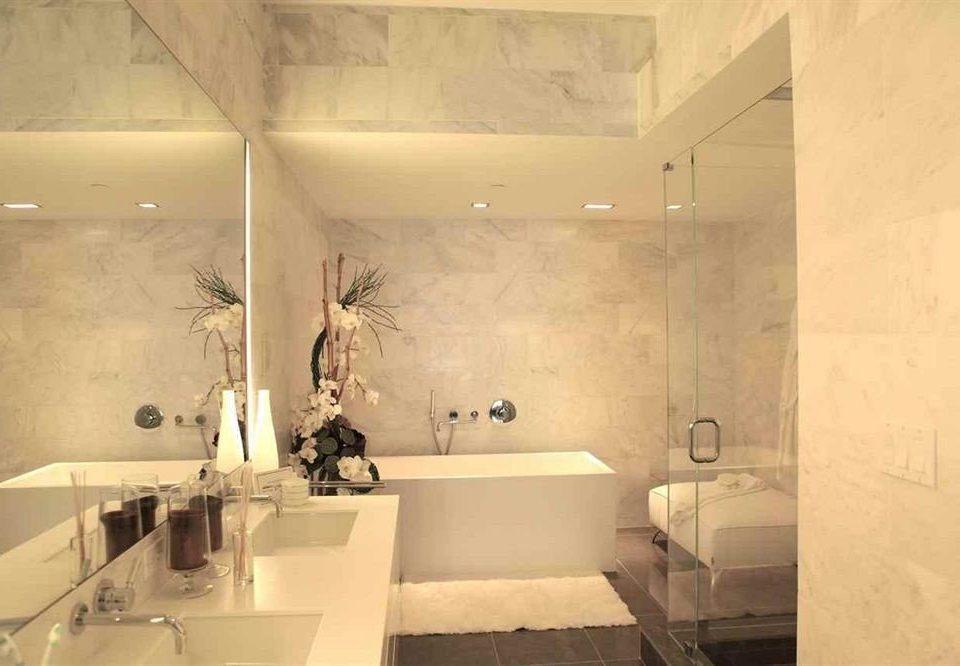 bathroom property lighting plumbing fixture tile flooring sink bathtub toilet tub