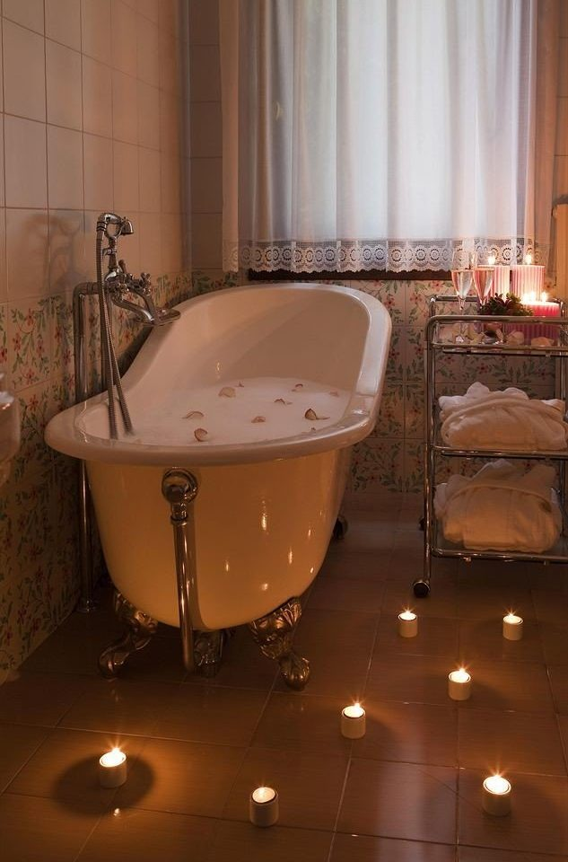 bathroom lighting plumbing fixture bathtub swimming pool flooring