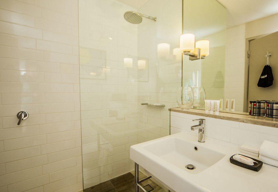 bathroom mirror sink property toilet flooring plumbing fixture bathtub tile tiled