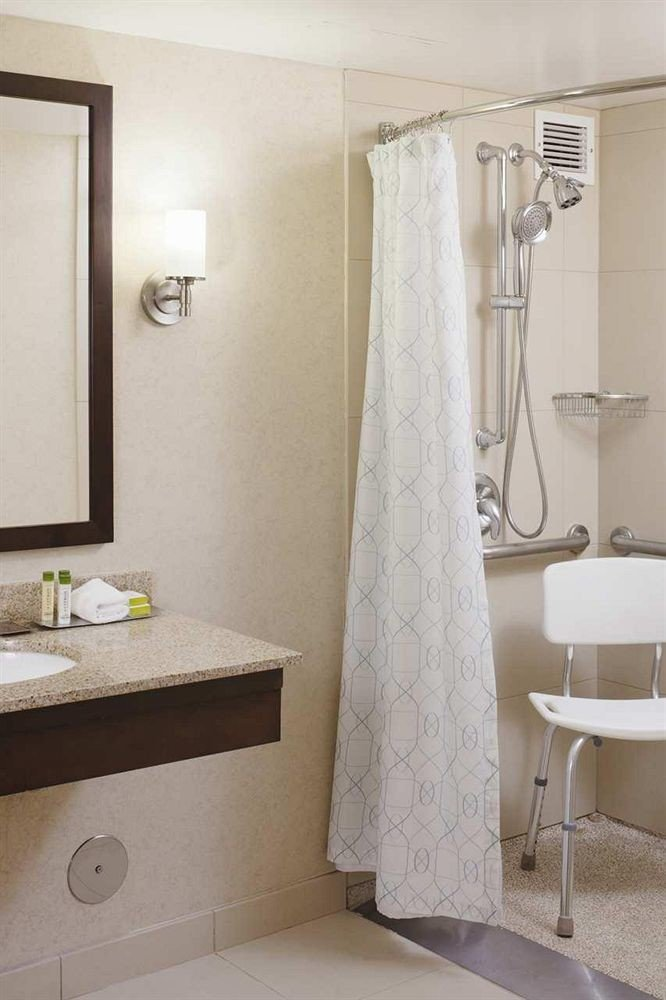 bathroom mirror property sink plumbing fixture towel bathtub flooring rack