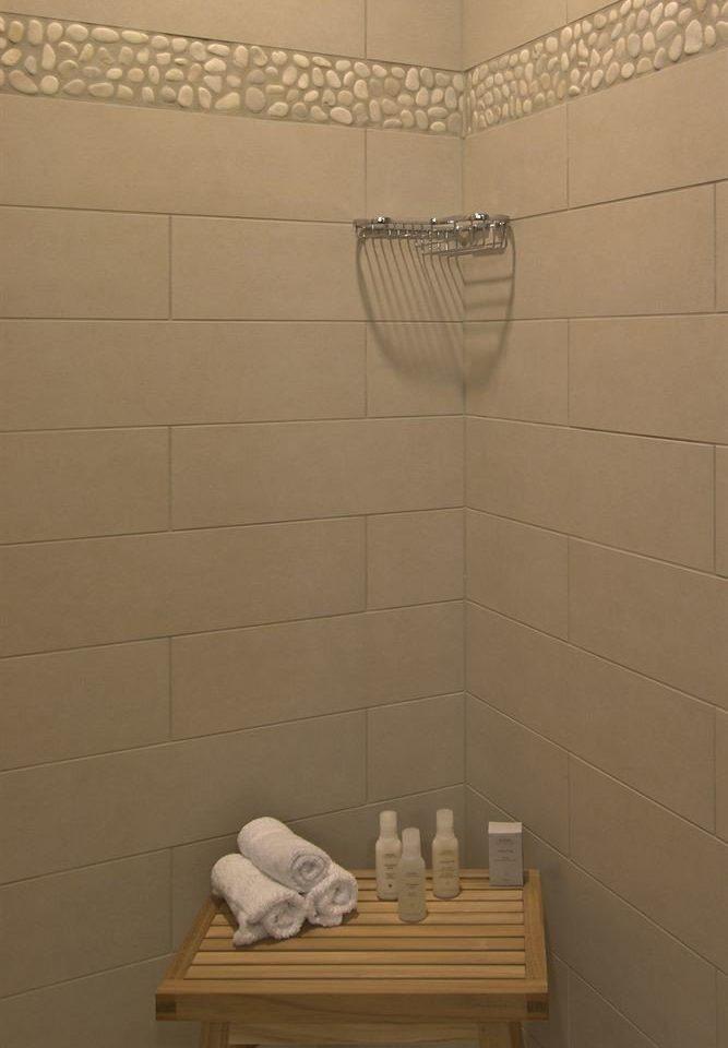 bathroom tile flooring plumbing fixture bathtub shower plaster tiled