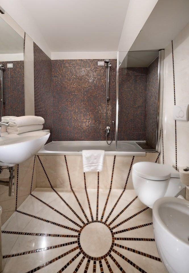 bathroom flooring plumbing fixture tile bathtub swimming pool tiled