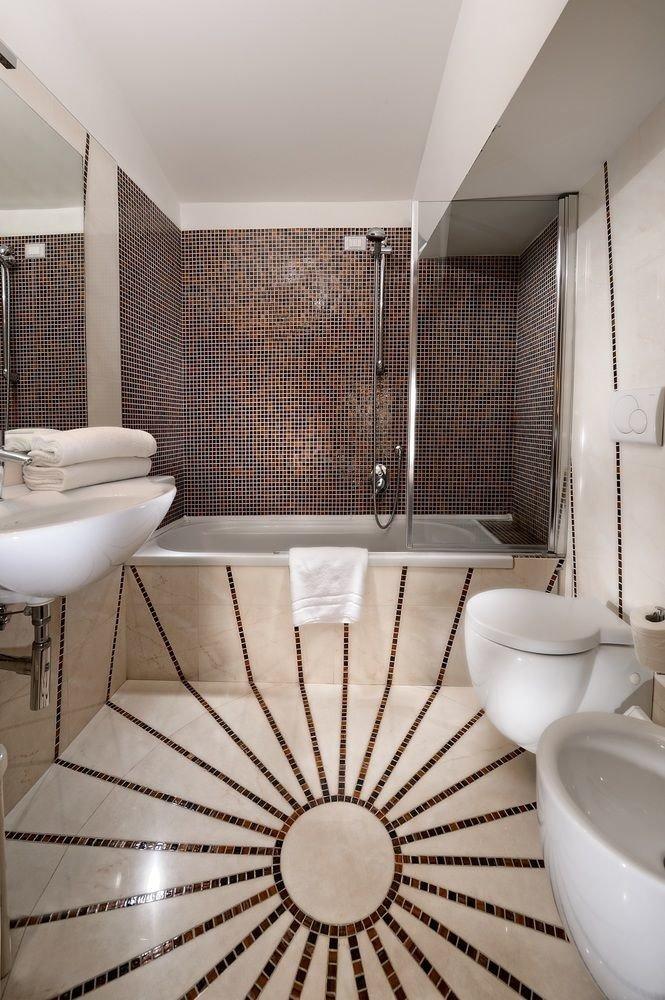 bathroom flooring plumbing fixture tile bathtub swimming pool tiled