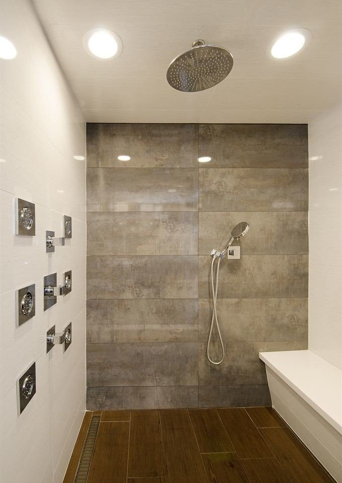 bathroom plumbing fixture flooring tile bathtub tiled