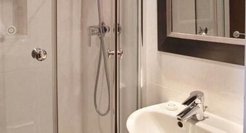 bathroom scene plumbing fixture sink white shower flooring bathtub