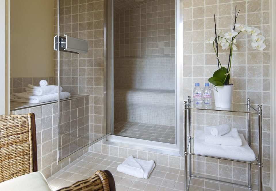 bathroom plumbing fixture flooring tile bathtub tiled