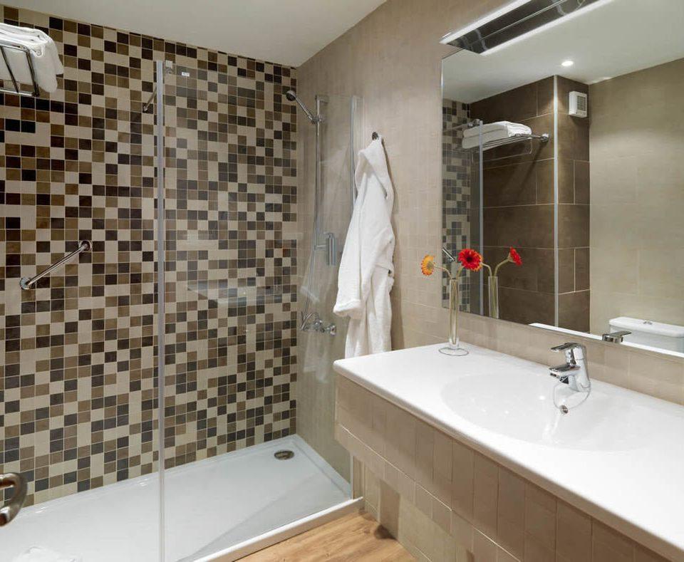 bathroom property sink plumbing fixture tile bathtub flooring tiled tan