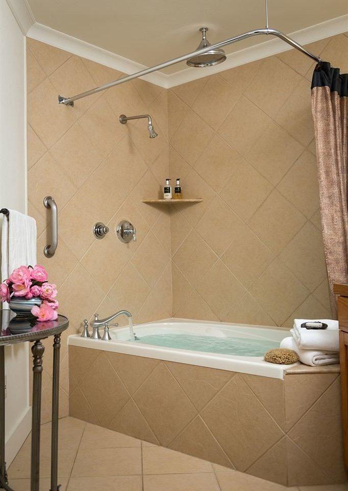 bathroom property bathtub plumbing fixture flooring tile swimming pool tiled