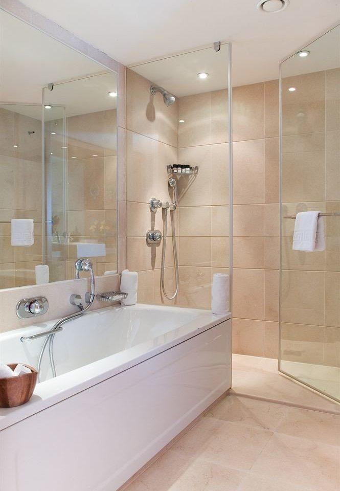 bathroom property vessel plumbing fixture bathtub toilet flooring tile tub tiled