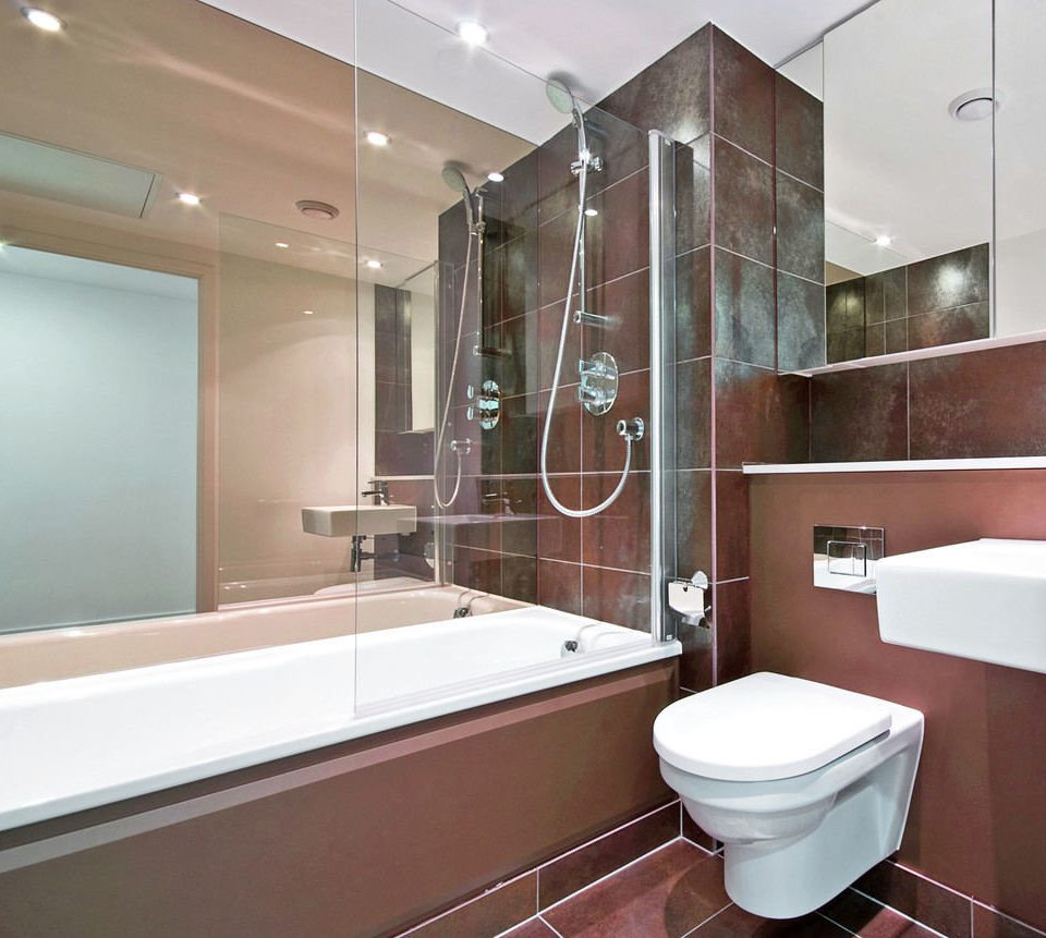 bathroom property bathtub flooring plumbing fixture tiled