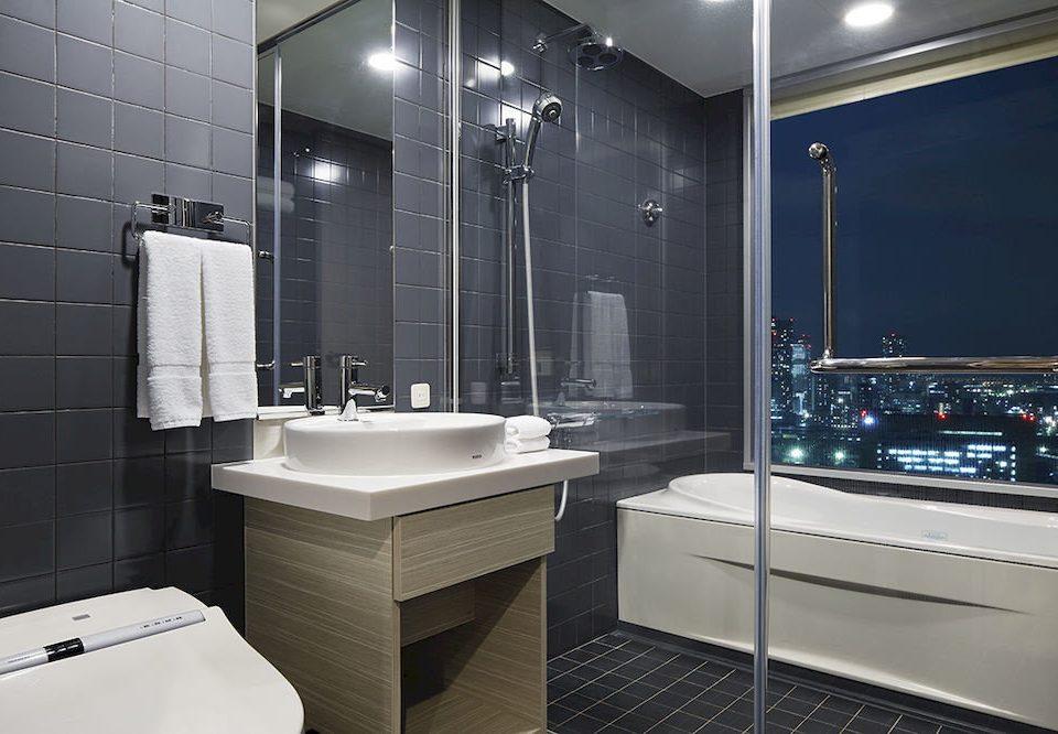 bathroom sink flooring plumbing fixture tile bathtub toilet tiled