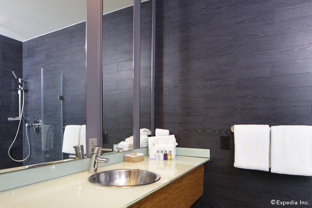 bathroom bathtub sink plumbing fixture flooring tile