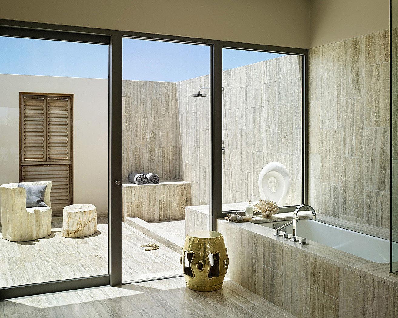bathroom property plumbing fixture flooring tile bathtub tan