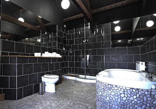 bathroom sink swimming pool toilet tile plumbing fixture flooring bathtub public toilet tiled tub
