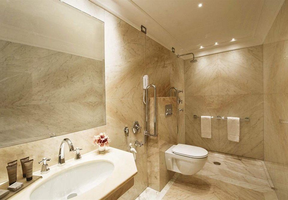 bathroom sink toilet property flooring plumbing fixture bathtub tan
