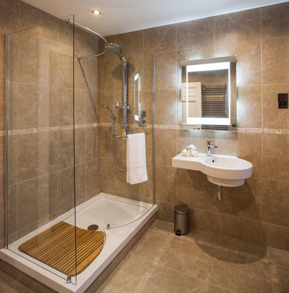 bathroom property plumbing fixture bathtub flooring tile toilet