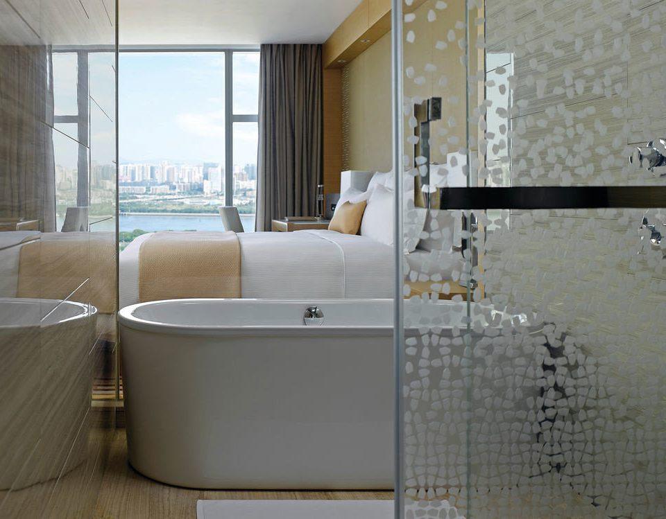 property bathroom bathtub plumbing fixture flooring tile public toilet toilet tiled