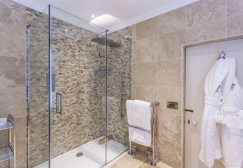 bathroom property plumbing fixture bathtub tile flooring shower