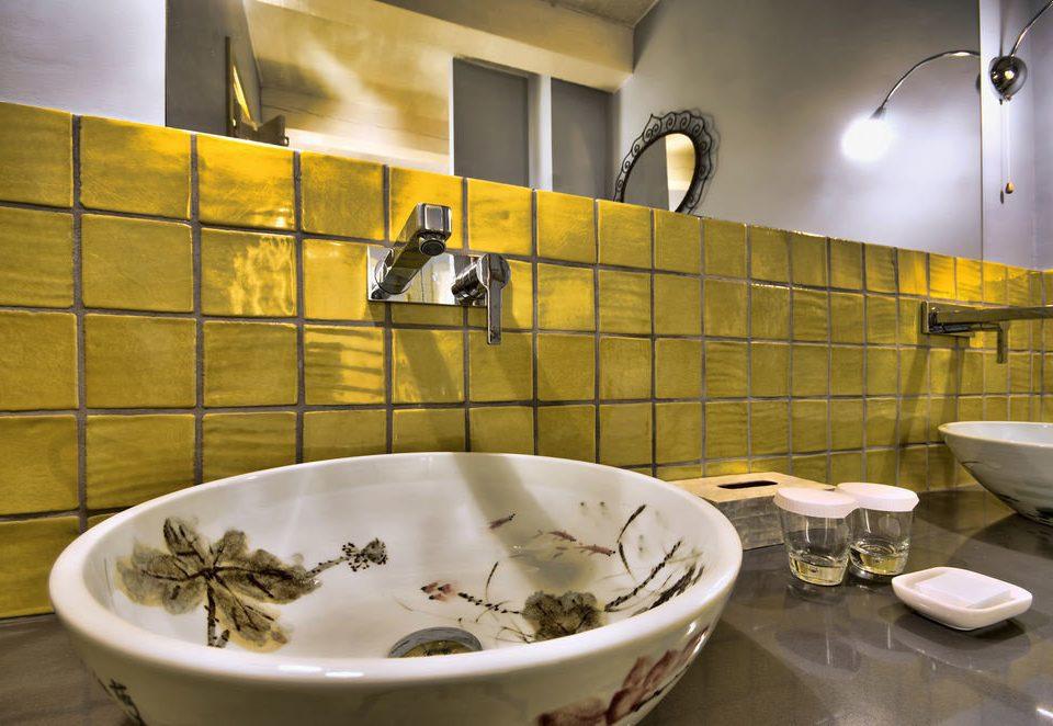 bathroom plumbing fixture bathtub flooring water basin