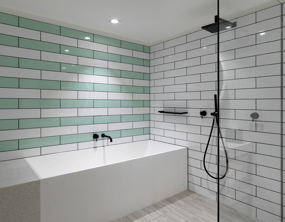 bathroom tile plumbing fixture flooring bathtub tiled