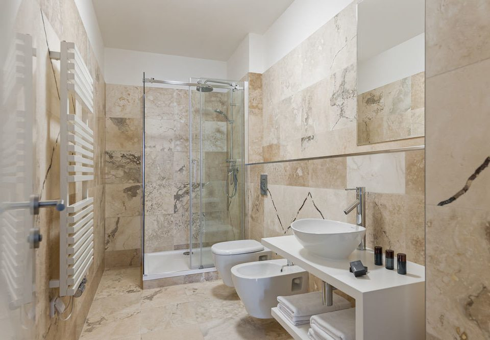 bathroom property plumbing fixture flooring tile bathtub