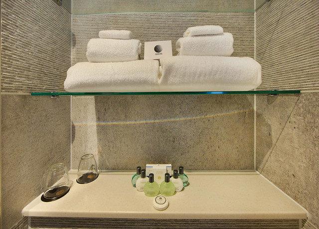 bathroom sink plumbing fixture swimming pool flooring bathtub towel
