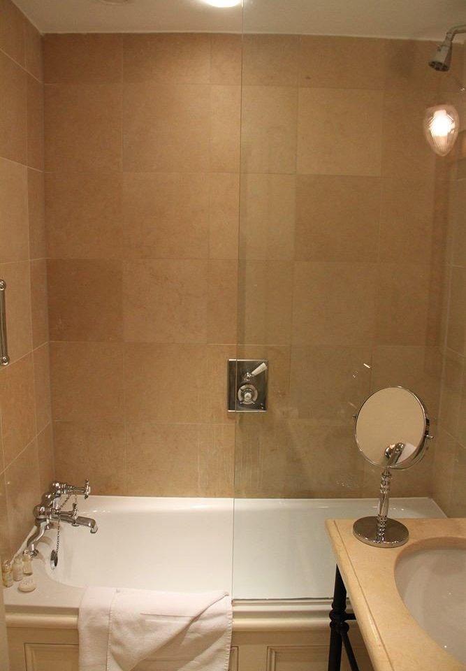 bathroom toilet property sink white plumbing fixture flooring tiled tile bathtub