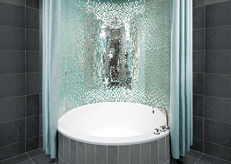 bathroom tiled green plumbing fixture white tile toilet bathtub stall public