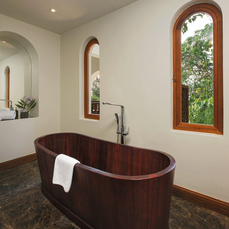 bathtub man made object bathroom property plumbing fixture hardwood swimming pool jacuzzi
