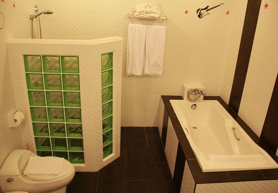 bathroom toilet property house sink home plumbing fixture bathtub tile tiled