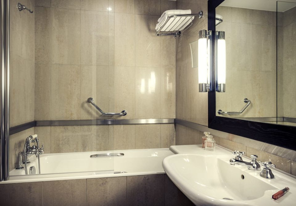 bathroom sink vessel mirror property toilet bathtub home plumbing fixture water basin tile tan