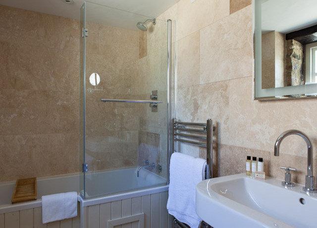 bathroom property sink toilet plumbing fixture white home bathtub tan tub tile tiled