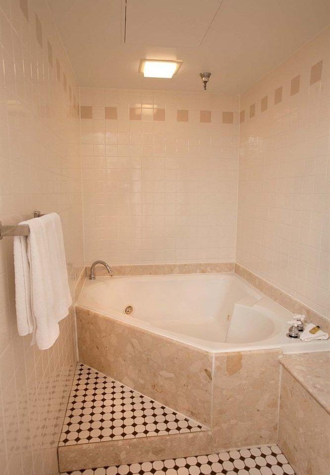 bathroom property swimming pool bathtub plumbing fixture jacuzzi vessel toilet tile tiled tub