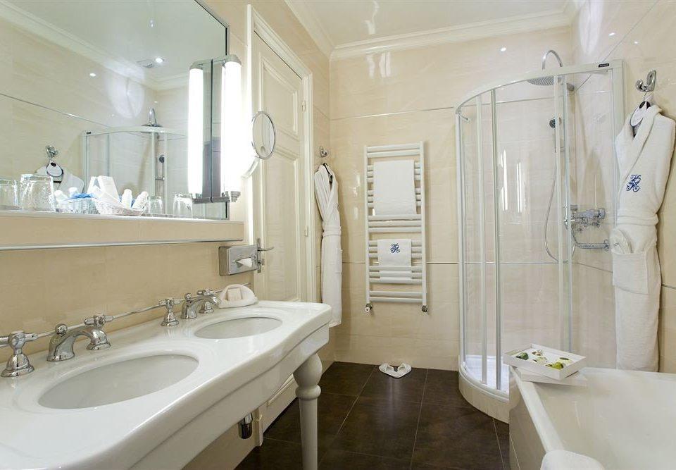 bathroom sink toilet mirror property white plumbing fixture tile bathtub