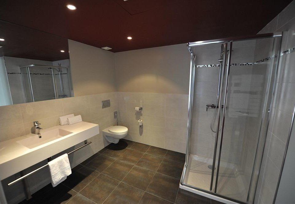 bathroom sink property mirror shower plumbing fixture toilet tile tub bathtub tiled