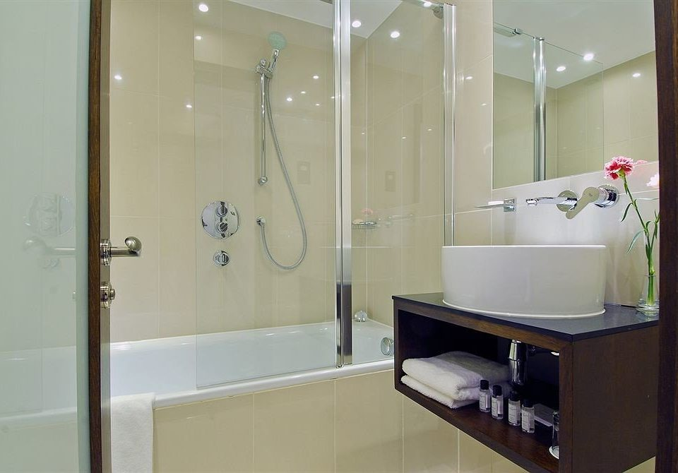 bathroom mirror property plumbing fixture bathtub sink