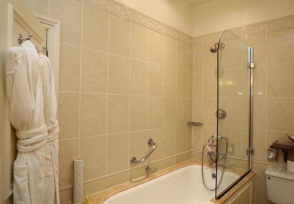 bathroom property plumbing fixture toilet sink bathtub tub tile tiled
