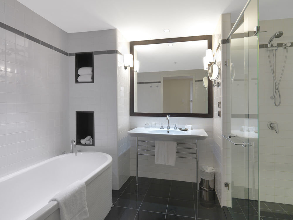 bathroom property toilet white public toilet plumbing fixture tile tiled bathtub