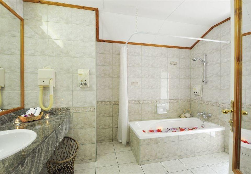bathroom property sink swimming pool plumbing fixture bathtub toilet tiled