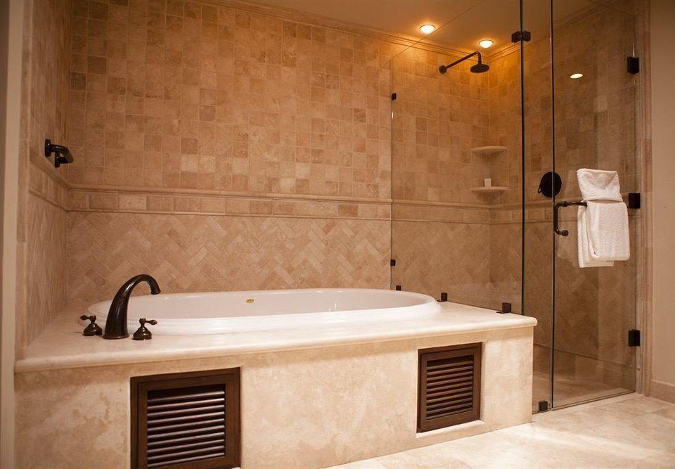 bathroom property bathtub plumbing fixture swimming pool vessel tub tiled