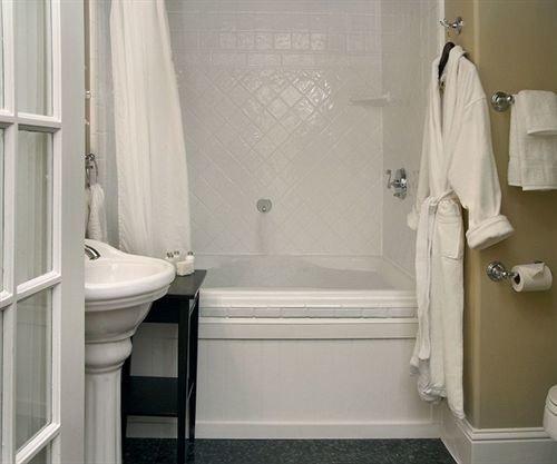 bathroom property toilet sink plumbing fixture white public toilet bathtub shower rack tub