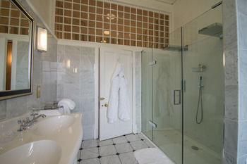 bathroom toilet property plumbing fixture sink tile tiled tub bathtub