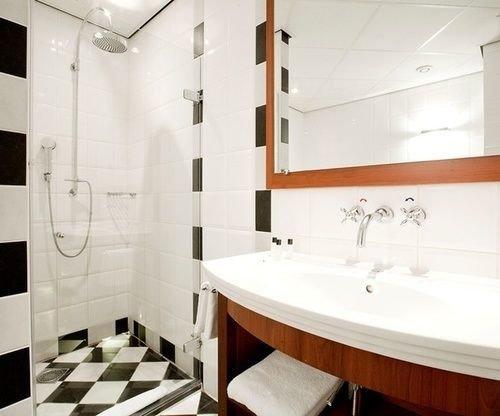 bathroom property sink white plumbing fixture bathtub tile tiled