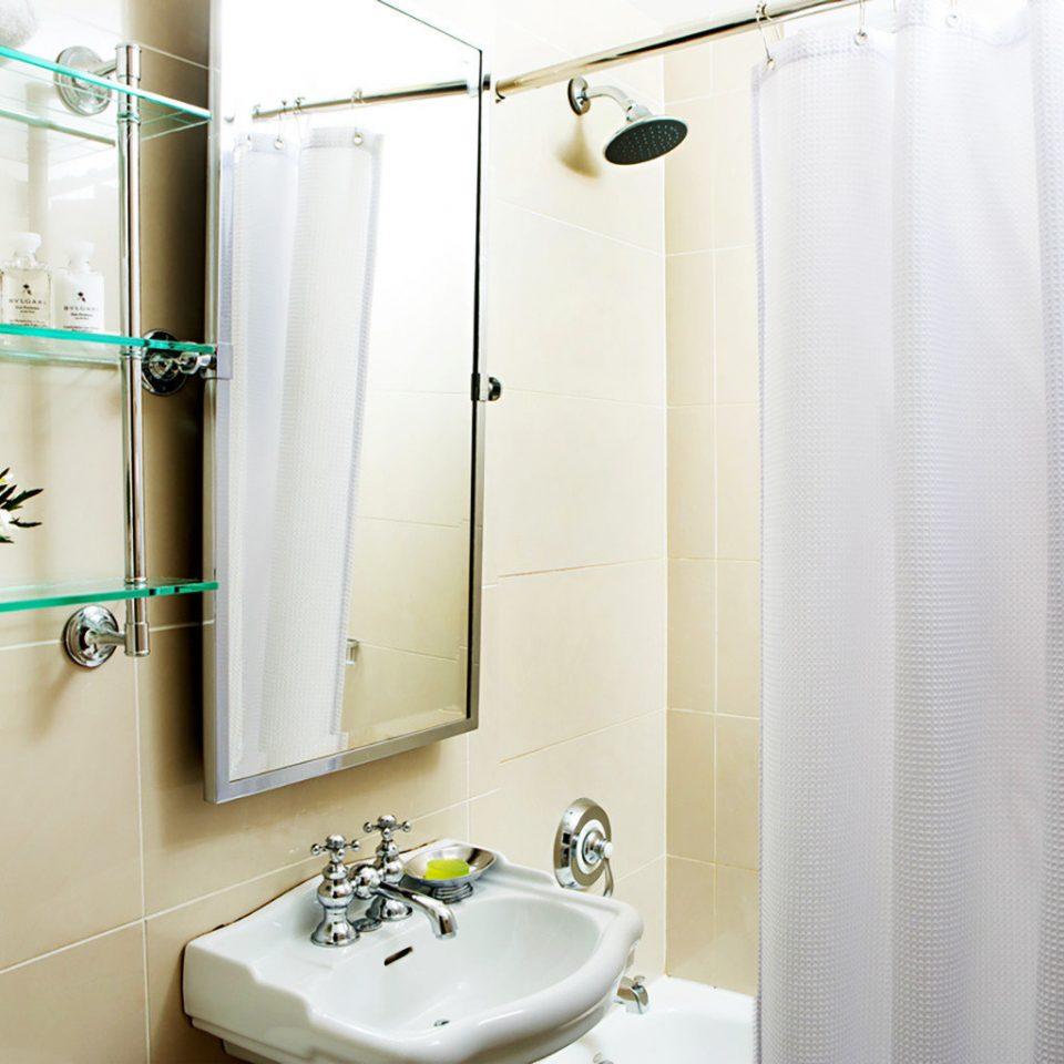 bathroom property sink white plumbing fixture bathtub